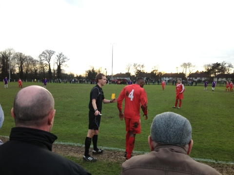 Walsall Wood's Shann Boothe receives a yellow card
