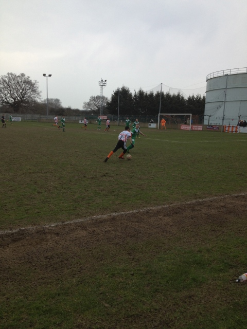 Ashford winger Samad Kazi tries to get the better of Slough's Danny Murphy