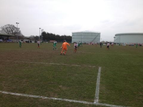 James Warrington gets to the ball ahead of Mario Quiassaca during a rare Ashford attack