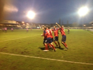Charlie Moone (furthest left) celebrates his dramatic late equaliser