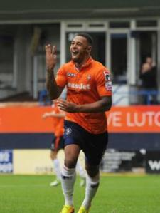 Andre Gray celebrates a hattrick