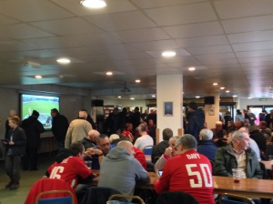 The packed Travis Perkins Lounge - beers are sipped & programmes pored over.