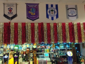 Esteemed company: pennants from several visiting Football League sides.