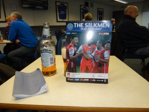 Settling down in the Corner Flag bar with some essential matchday supplies.